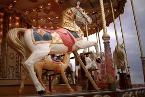 Low angle of a sculpted horse on a carousel in Paris, France