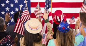 American people wave flags at political rally. USA.