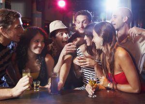 Hispanic friends drinking at bar