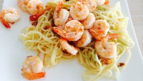 High Angle View Of Pasta With Shrimps Served In Plate