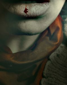 Close-up of a womans lips bleeding