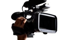 Hand holding HD broadcast camcorder.