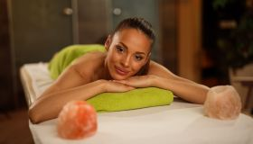 Young woman relaxing on massage table at health spa