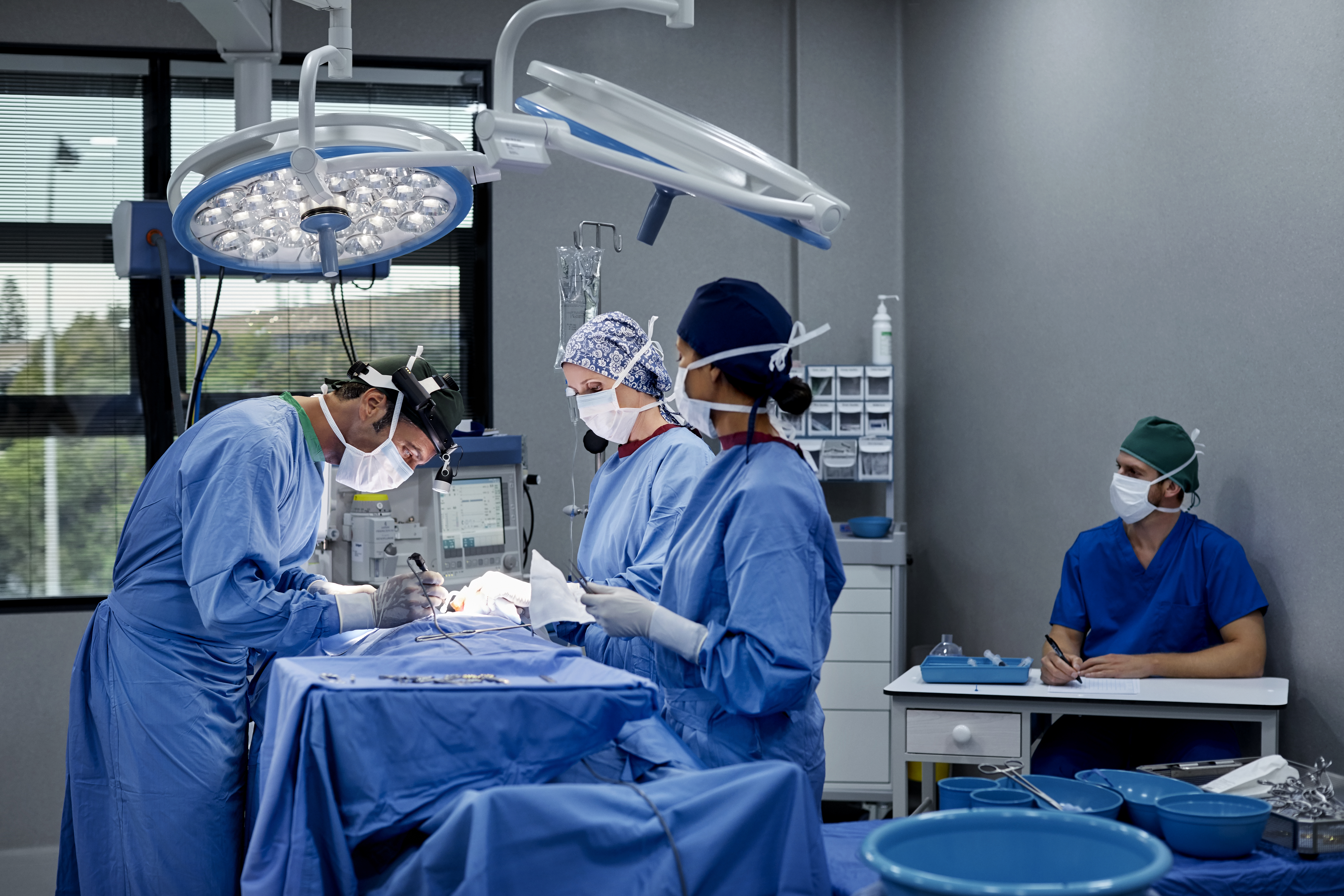 Surgeons operating patient in hospital
