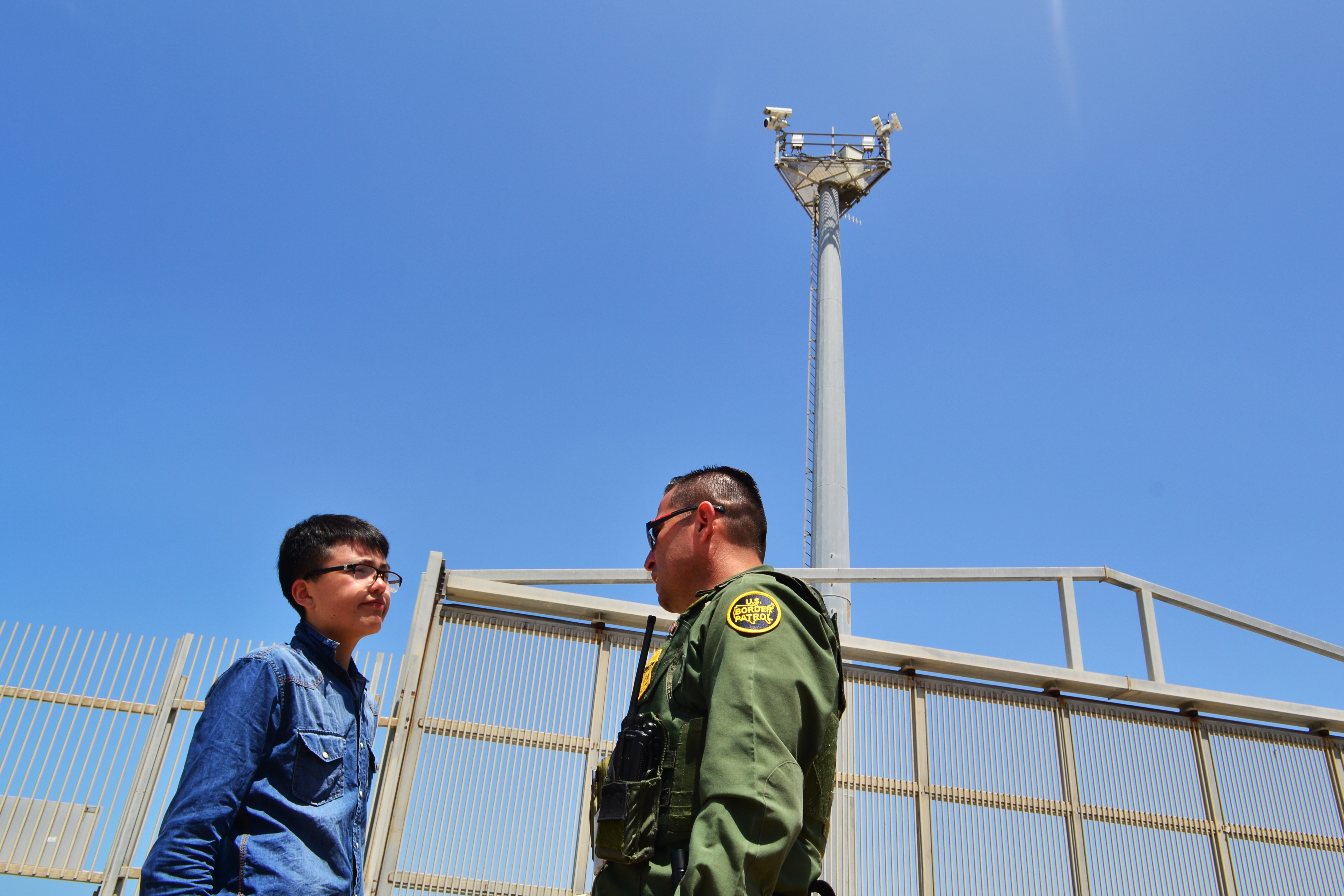 A visitor seen talking to a Border Patrol agent in...