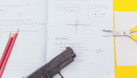 above view student notebook and handgun