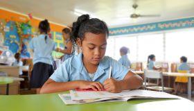 Young Pacific Islander girl study in school in Rarotonga Cook Islands