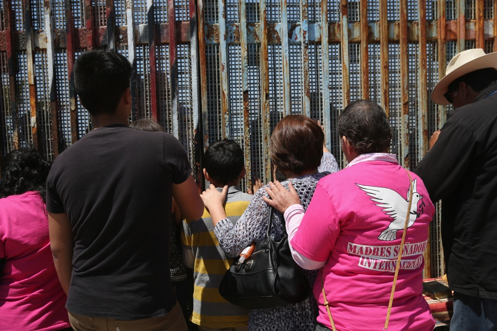Mexicans Meet Separated Family Members Through U.S.-Mexico Border Fence In Tijuana