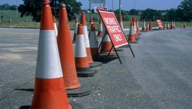 Traffic cones separating construction site and works access from public highway during construction of Great Leighs bypass. Essex, United Kingdom.