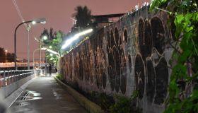 Street Amidst Illuminated City Against Sky At Night