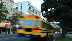 Photo of a moving yellow school bus