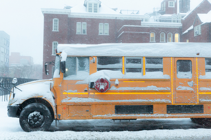 Yellow School Bus Parked on Road in a Snowstorm