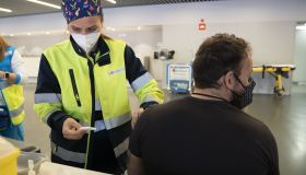 Wanda Stadium kicks-off Covid-19 vaccinations with police and fire forces receiving the first round in Madrid, Spain