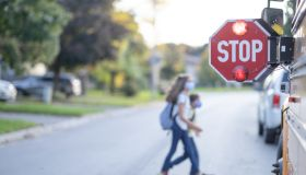 School bus stop sign for children to pass