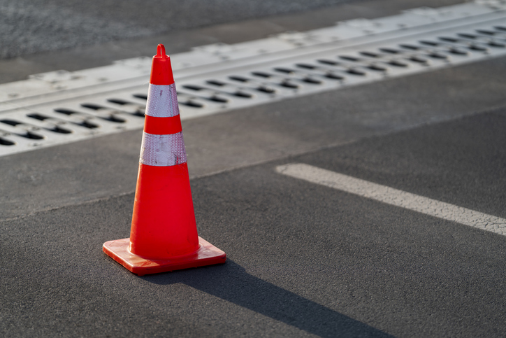 Traffic cone,an image of cautions on asphalt road