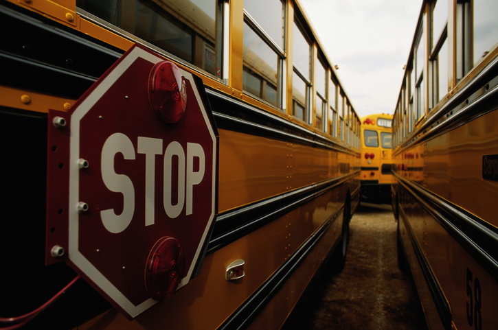 Stop sign on side of school bus, close-up, Indiana, USA