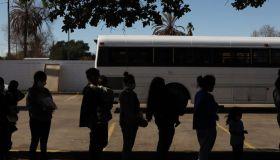 Migrants At Border As Biden Confirms Raising Trump Refugee Cap After Outcry