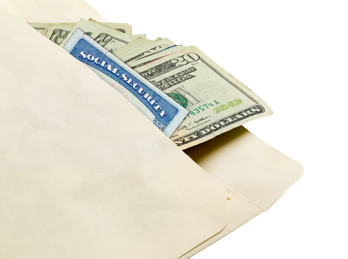 High Angle View Of Paper Currency And Social Security Card In Envelope Against White Background