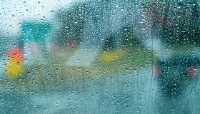 Rain drops on a bus window driving through Boston